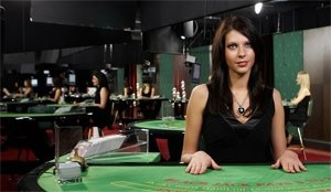 dealer vid black jack bord